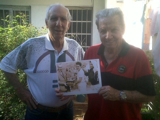 Orlando (left) and Reynaldo Garrido, former Cuban tennis stars who won the Canadian Open in 1959, pose with a photograph of their victory at Orlando's house in Havana.